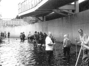 Walkers of all ages passing through a typical concrete channel section