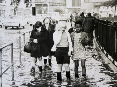 Children wade home from school by the River Quaggy, central Lewisham