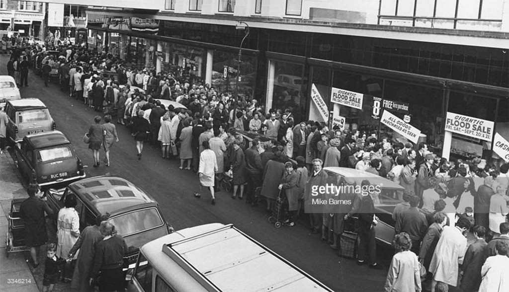 People queue for the 'flood sale' at Chiesmans department store